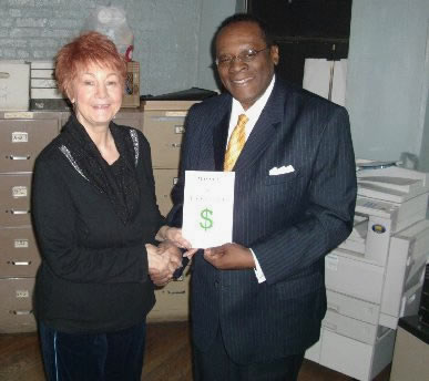 Dr. Reid presenting a copy of his book to Edith M. Stranges